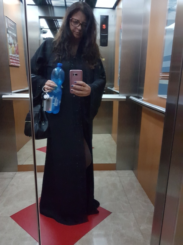 full body in abaya in elevator