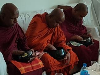 3 monks eating at Princess