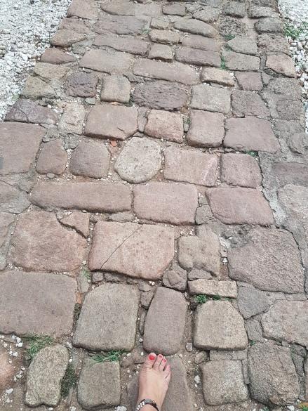 sri lanka bare foot on cobblestone path