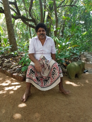 sri lanka grounds keeper on meditation island