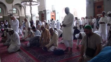 men praying