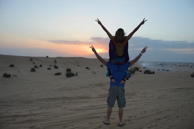 eliza and peter facing sunset safari
